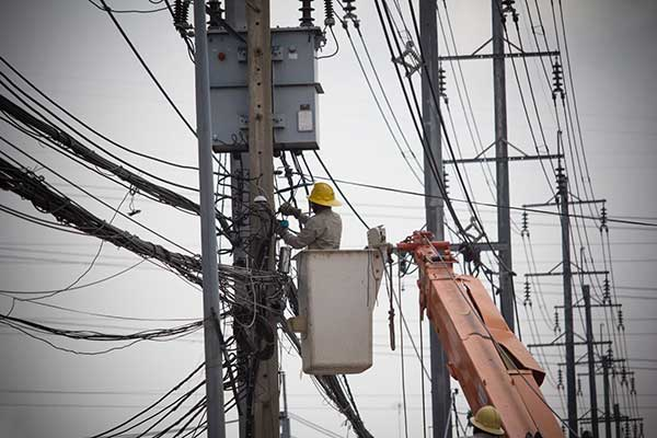 What Are Power Outages? | Worker fixing power lines